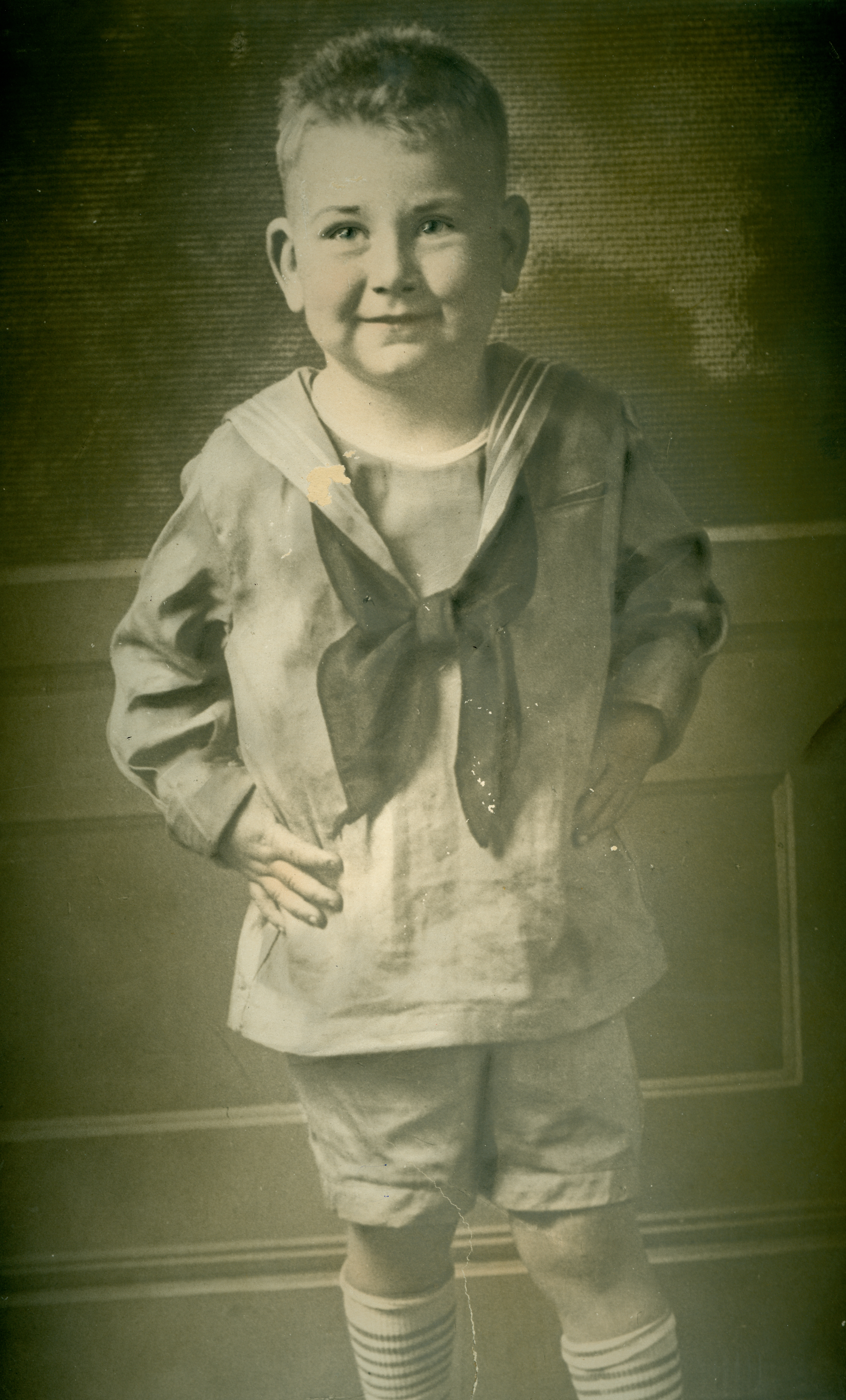 Does anyone recognize this adorable little boy?  His portrait was discovered inside a frame purchase